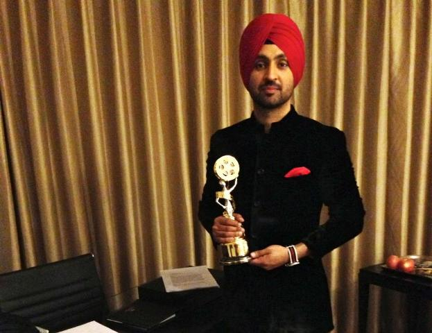 Diljit Dosanjh posing with the award